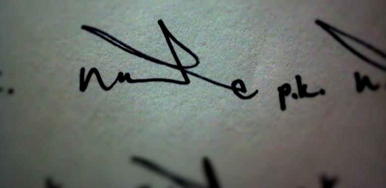 nate p k written out logo