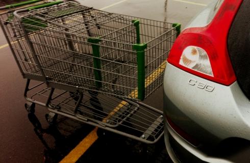 Vovlo C30 R Design. Carts against car.